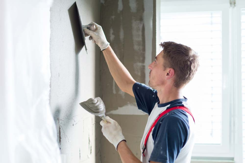 handyman applying plaster